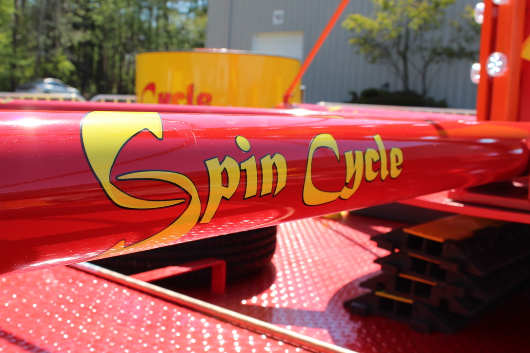 Spin Cycle logo on ride support arm