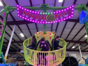 People riding Hypnotic ride