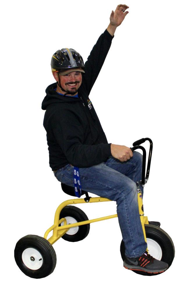 Guy riding on wacky trikes